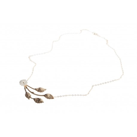 <p>Gold filled chain adorned with 18k gold plated branch and m.o.p. flower.</p>