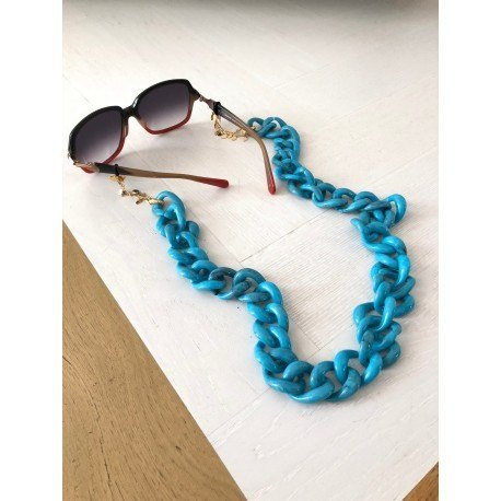 <p><span>Jewel chain for any type of glasses!</span></p> <p></p> <p><span>Turquoise resin link chain with 18k gold plated leaves chain. Adorned with gold flower charm.</span></p> <p><span>Aprox. length: 80cm</span></p>
